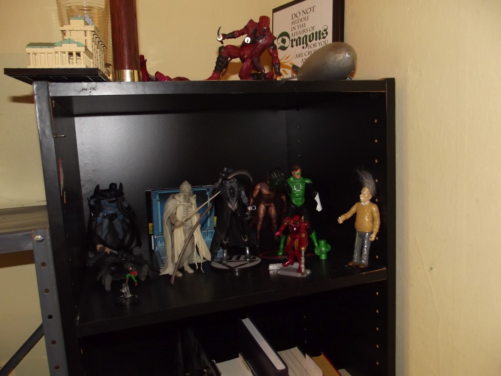 Action figures on a black shelf
