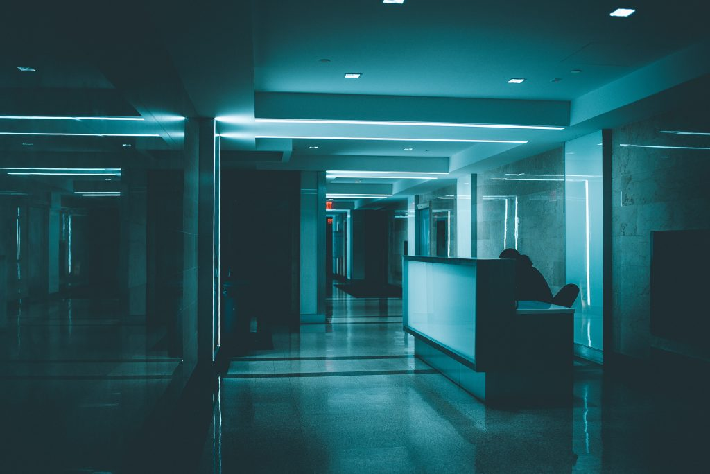 Dimly lit hospital corridor and desk