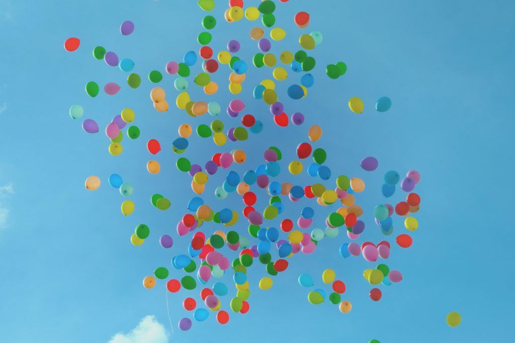 Balloons released against a blue sky. A detour to the hospital: Sickness derails us