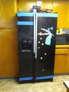 Beat up old fridge