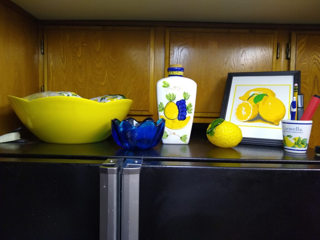 Yellow and blue decorations on top of fridge