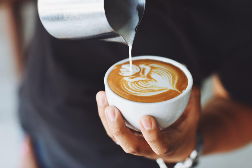 Barista preparing coffee drink